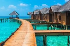 Over-water-bungalows-with-steps-into-amazing-green-lagoon