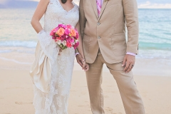 Bride-&-groom-holding-hands-on-the-beach