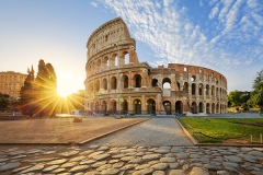 View-of-Colosseum-in-Rome-and-morning-sun,-Italy,-Europe