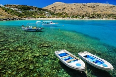 view-of-the-coast-with-boats-in-Lindos-bay,-Greece